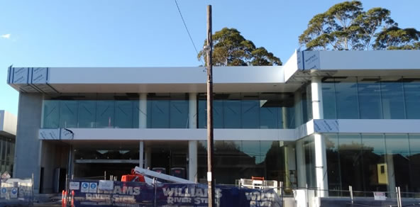 Alutile Panels being fitted to a commercial building